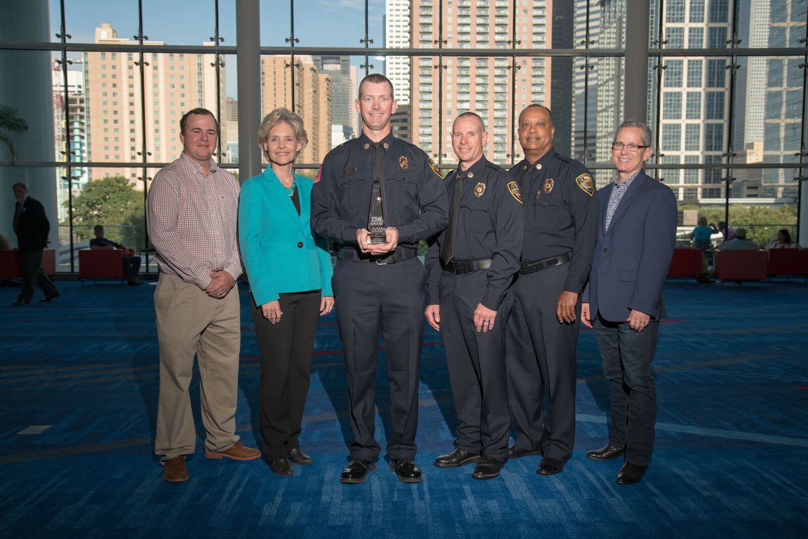 6 Kerrville employees together with one holding award at event