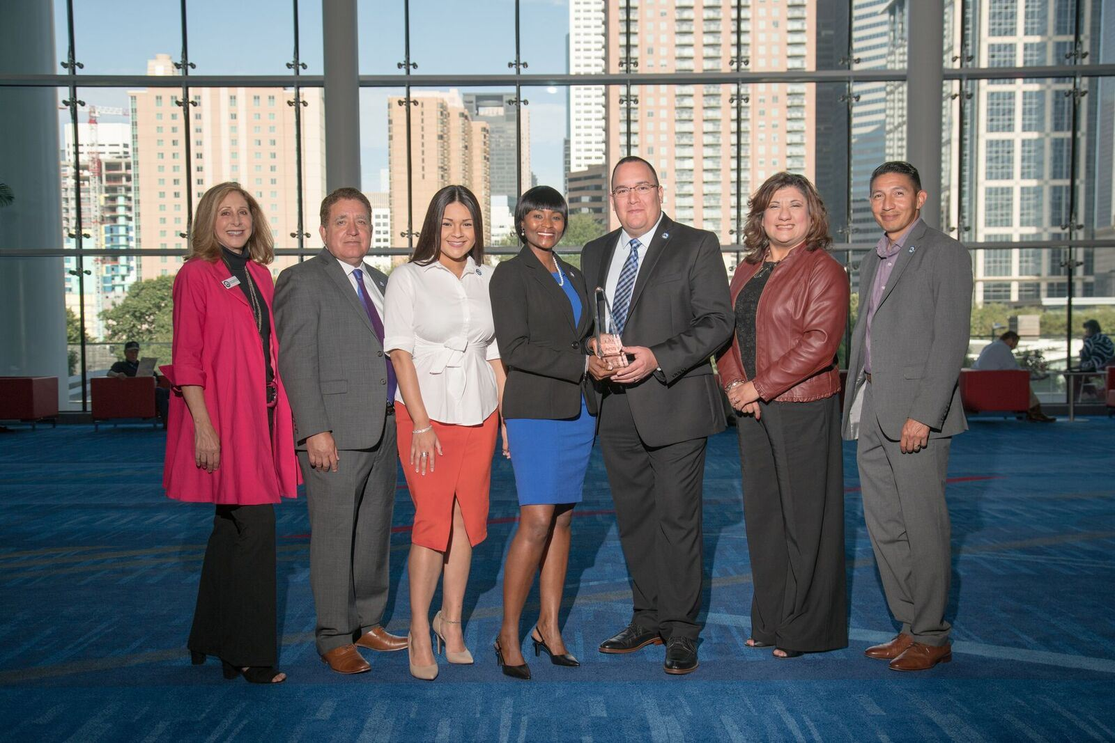 7 Corpus Christi employees together with one holding award at event